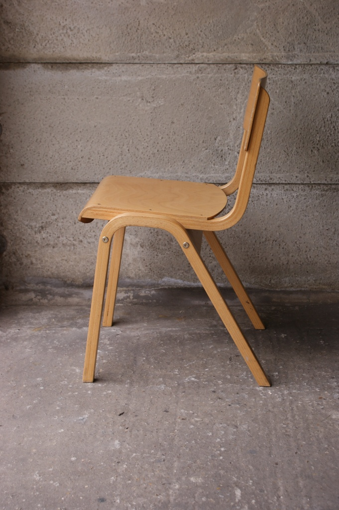 Vintage plywood stacking chair side view